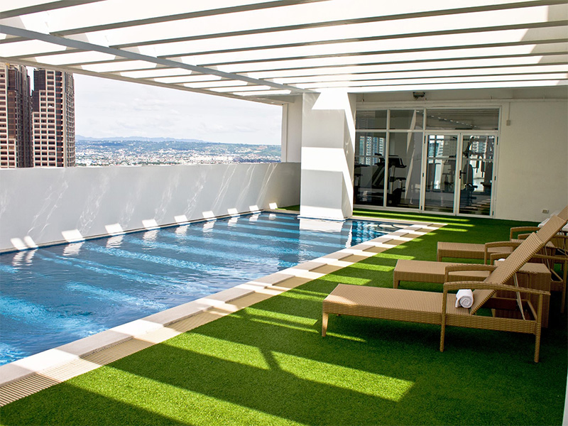 Pool area at Privato Ortigas